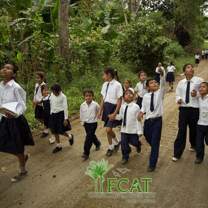 A group of school kids walk together on a trail