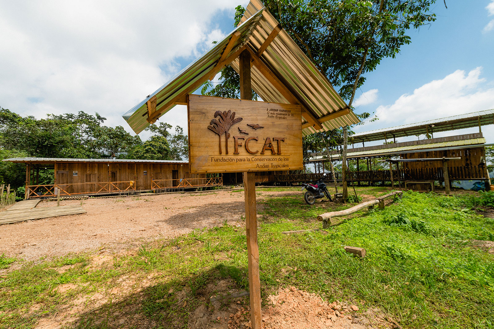 A carved wooden sign stands at the entrance to the FCAT station
