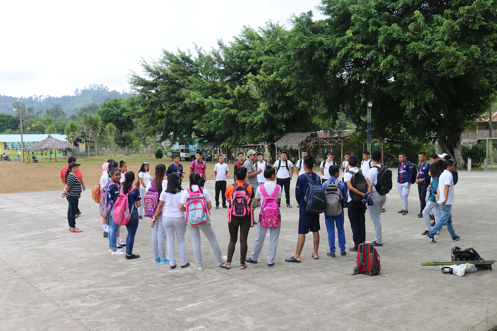 Students stand in a circle outside